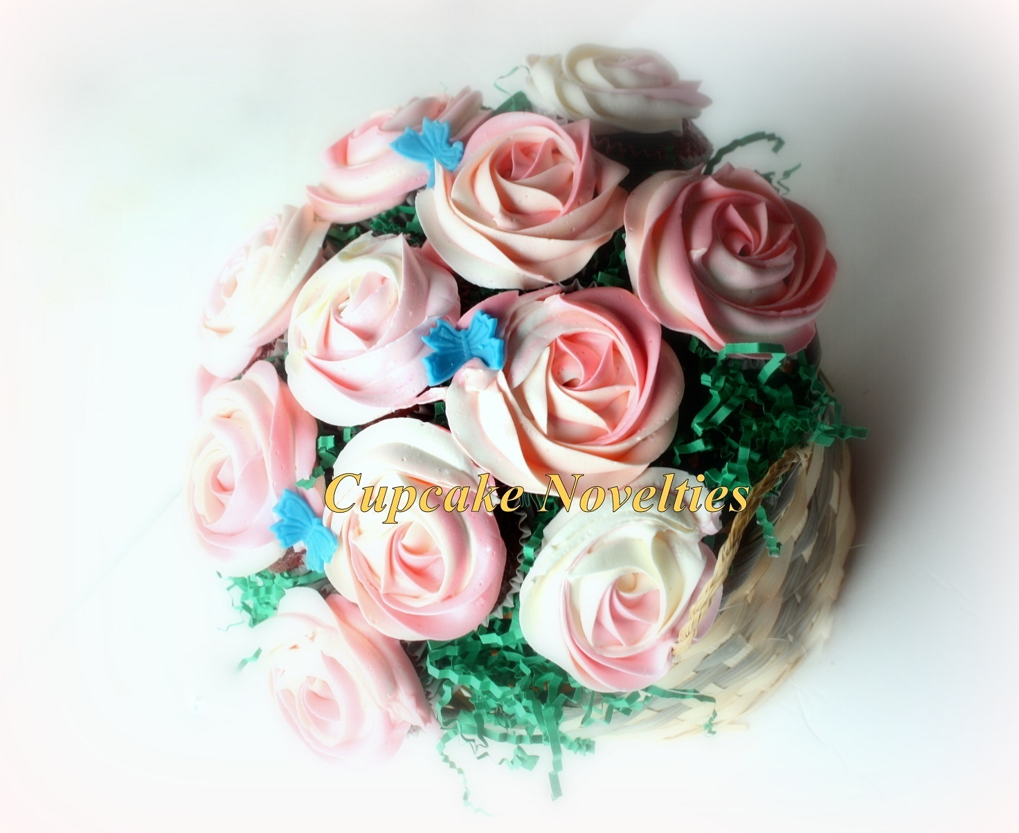 Shaded Pink & White Roses Cupcake Bouquet with blue butterflies!